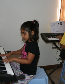 Student playing keyboard